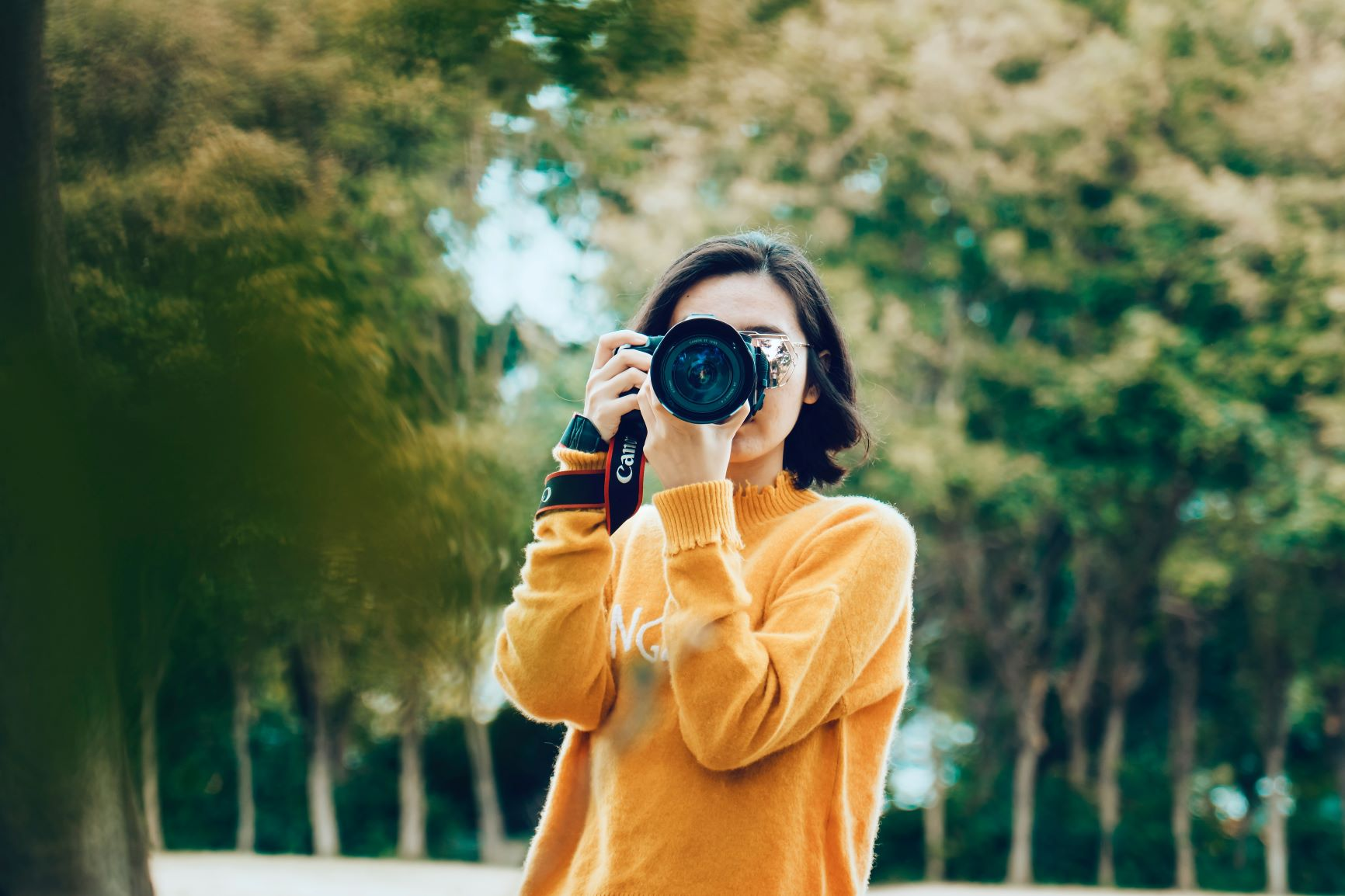 Girl with a camera taking a photograph